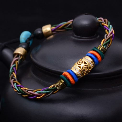 Women'sTibetan Style Woven Bracelet - AwesomeGraphix.com - T-Shirts, Caps, Mugs, Baby Onesies, Wall Art and more!