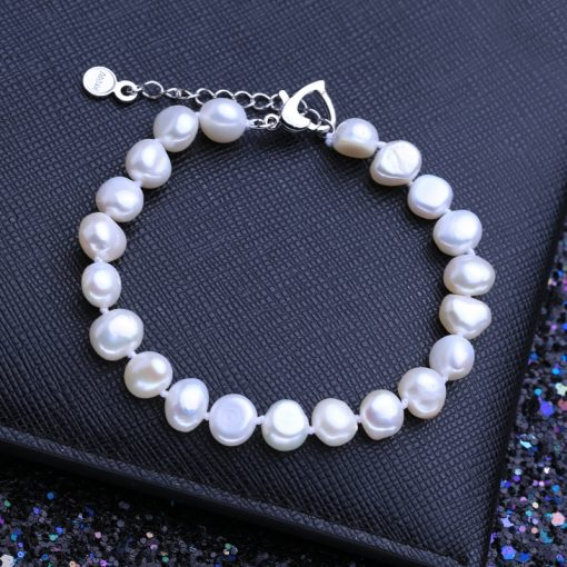 Women's Adjustable Natural Pearls Bracelet - AwesomeGraphix.com - T-Shirts, Caps, Mugs, Baby Onesies, Wall Art and more!